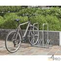 https://www.4mepro.es/23483-medium_default/aparcabicicletas-de-suelo-para-3-bicicletas-cara-a-cara-2-arcos-antirrobo.jpg